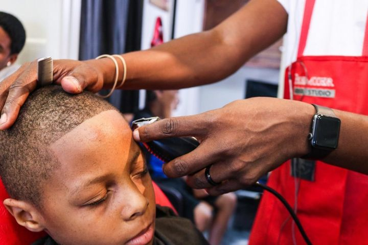 Kids in Cleveland were treated to free back-to-school haircuts and school supplies at Premier Barber Studio over the weekend.