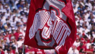 7 OCT 1995:  AN OHIO STATE FLAG IS WAVED TO THE CROWD DURING A 28-25 WIN OVER PENN STATE AT BEAVER STADIUM IN UNIVERSITY PARK, PENNSYLVANIA.  MANDATORY CREDIT:  DOUG PENSINGER/ALLSPORT