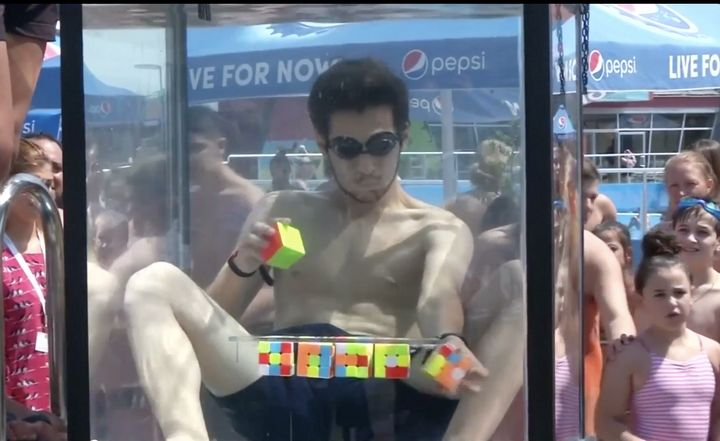 Vako Marchelashvili, 18, of Tbilisi, Georgia, solved six Rubiks Cubes under water in one breath on Friday in a bid to set a n