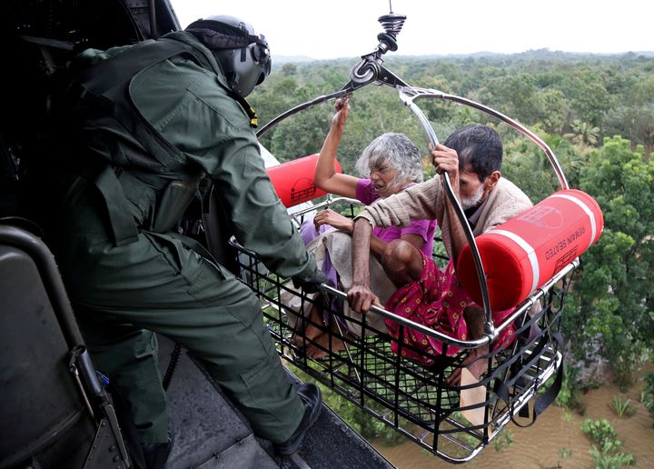 People are airlifted by the Indian Navy soldiers during a rescue operation at a flooded area in the southern state of Kerala,