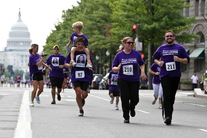 Runners approach the finish line at the Pancreatic Cancer Action Network's PurpleStride 5K Run/Walk on June 16, 2012.