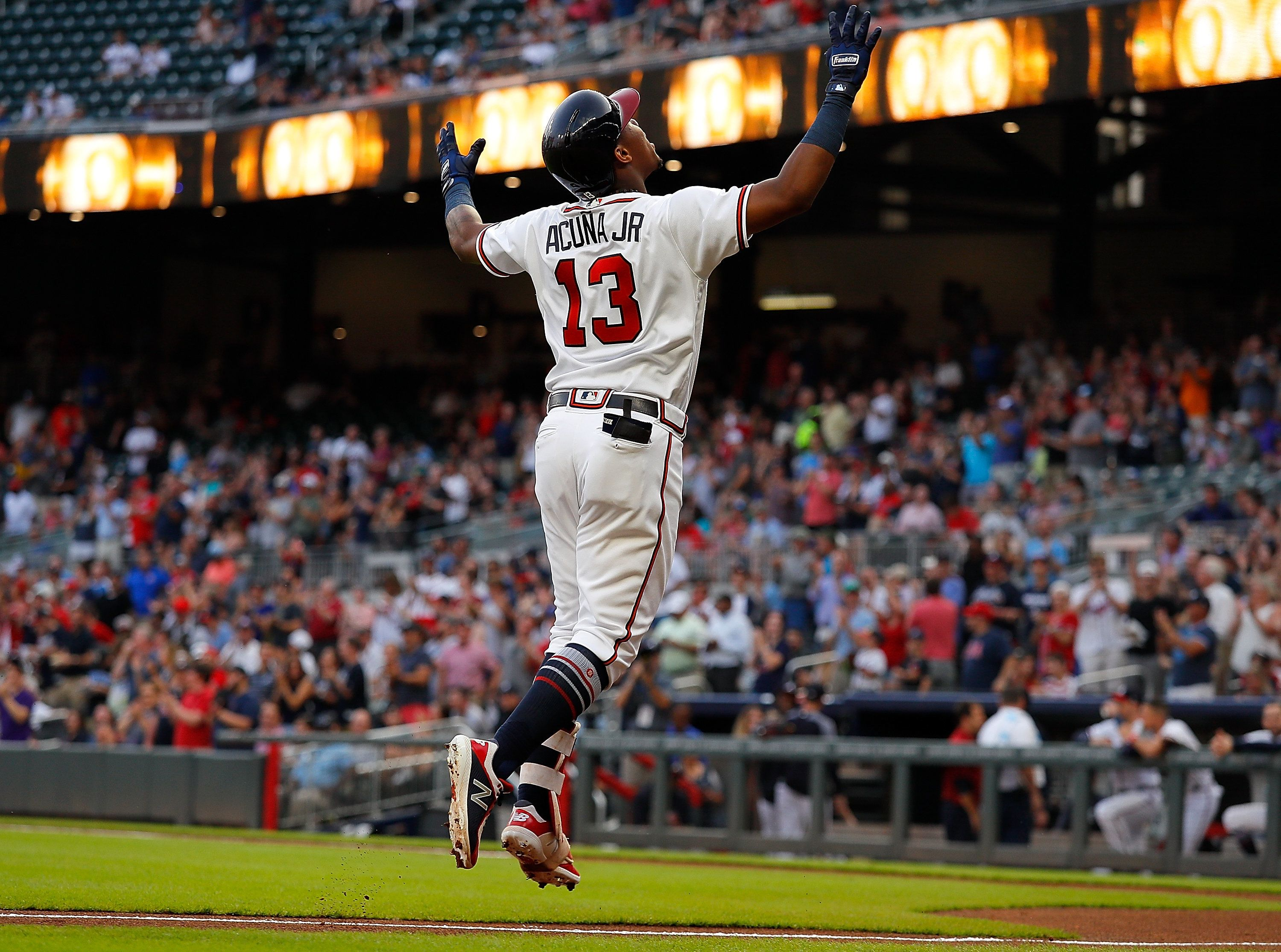 ATLANTA, GA - AUGUST 13:  Ronald Acuna Jr. #13 of the Atlanta Braves reacts after hitting a solo homer to lead off game two of a doubleheader against the Miami Marlins at SunTrust Park on August 13, 2018 in Atlanta, Georgia.  (Photo by Kevin C. Cox/Getty Images)