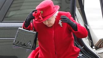 Britain's Queen Elizabeth arrives on a windy day to visit her grandson, Prince William, at RAF Valley, in north Wales April 1, 2011.  Prince William, who is due to marry Kate Middleton on April 29,  is serving as a search and rescue helicopter pilot, based at RAF Valley on Anglesey, an island off the north west coast of Wales.     REUTERS/Phil Noble (BRITAIN - Tags: ENTERTAINMENT ROYALS)