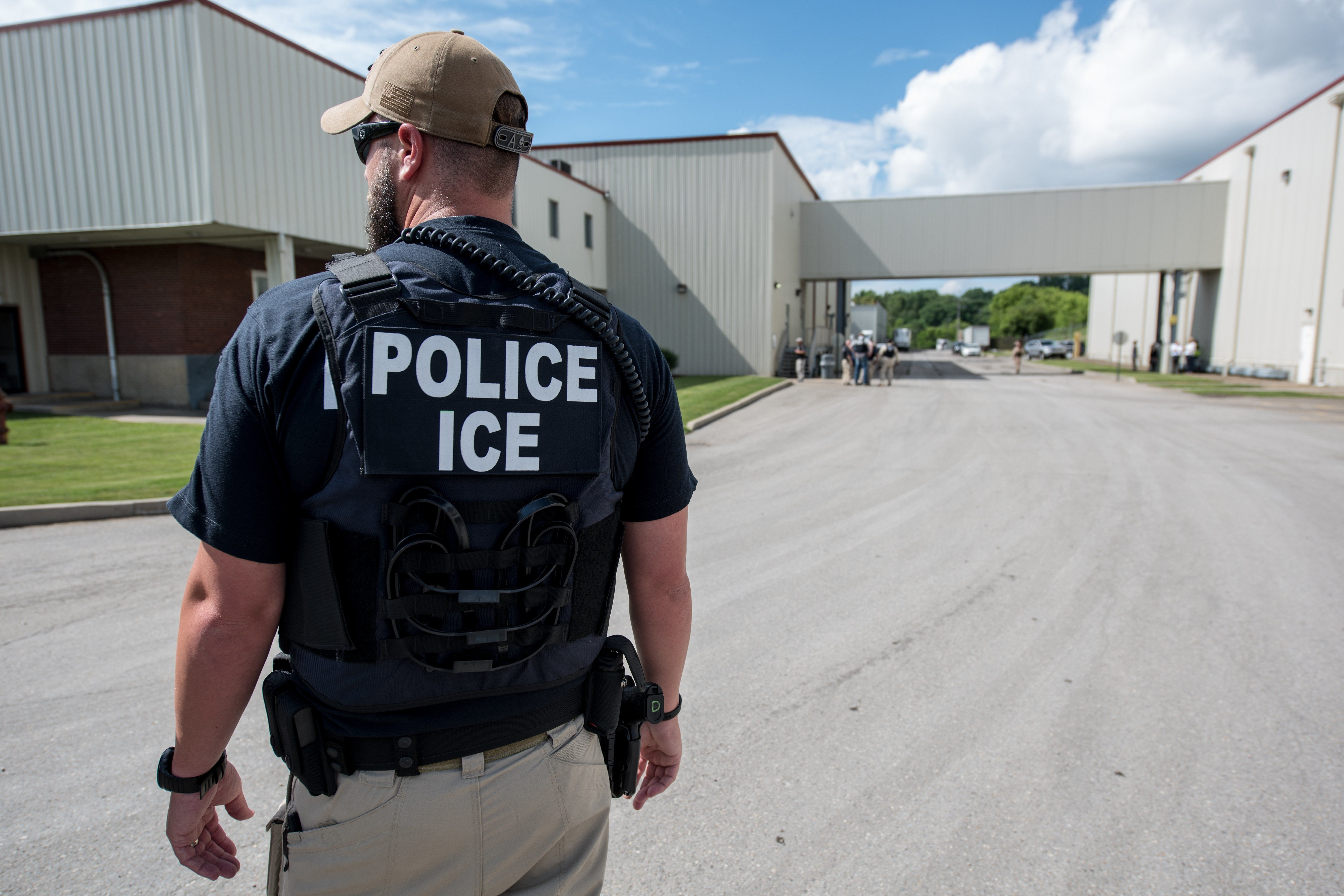US Immigration and Customs Enforcement's (ICE) special agent preparing to arrest alleged immigration violators at Fresh Mark, Salem, June 19, 2018. Image courtesy ICE ICE / U.S. Immigration and Customs Enforcement. (Photo by Smith Collection/Gado/Getty Images)