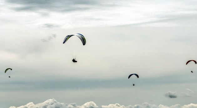 A British paraglider was killed after a mid-air collision with another pilot.