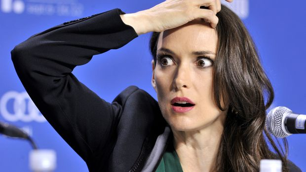 """Actress Winona Ryder reacts during a news conference for the film """"The Iceman"""" at the 37th Toronto International Film Festival, September 10, 2012.     REUTERS/Mike Cassese   (CANADA - Tags: ENTERTAINMENT HEADSHOT)"""