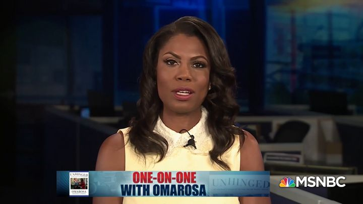 Former White House aide Omarosa Manigault-Newman on Sunday called President Donald Trump a racist who uses people as props.