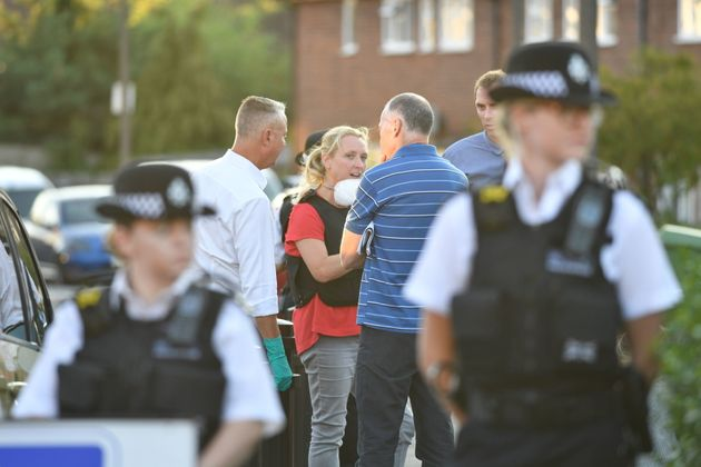 Police talk to residents in Adderley Gardens, Greenwich, south-east London, following the attack.