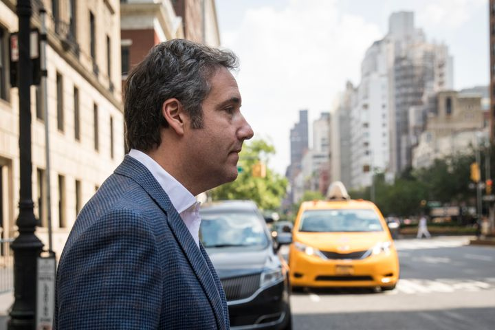 Michael Cohen, former personal attorney for President Donald Trump, exits the Loews Regency hotel and walks toward a taxi cab