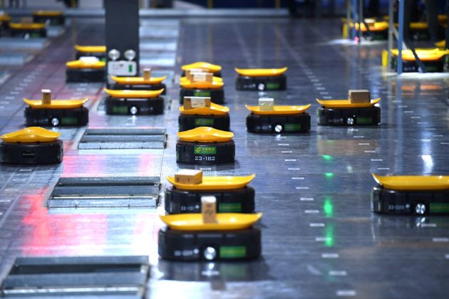 'Minions' intelligent sorting robots work at a warehouse on November 9, 2017 in Hefei, Anhui Province...