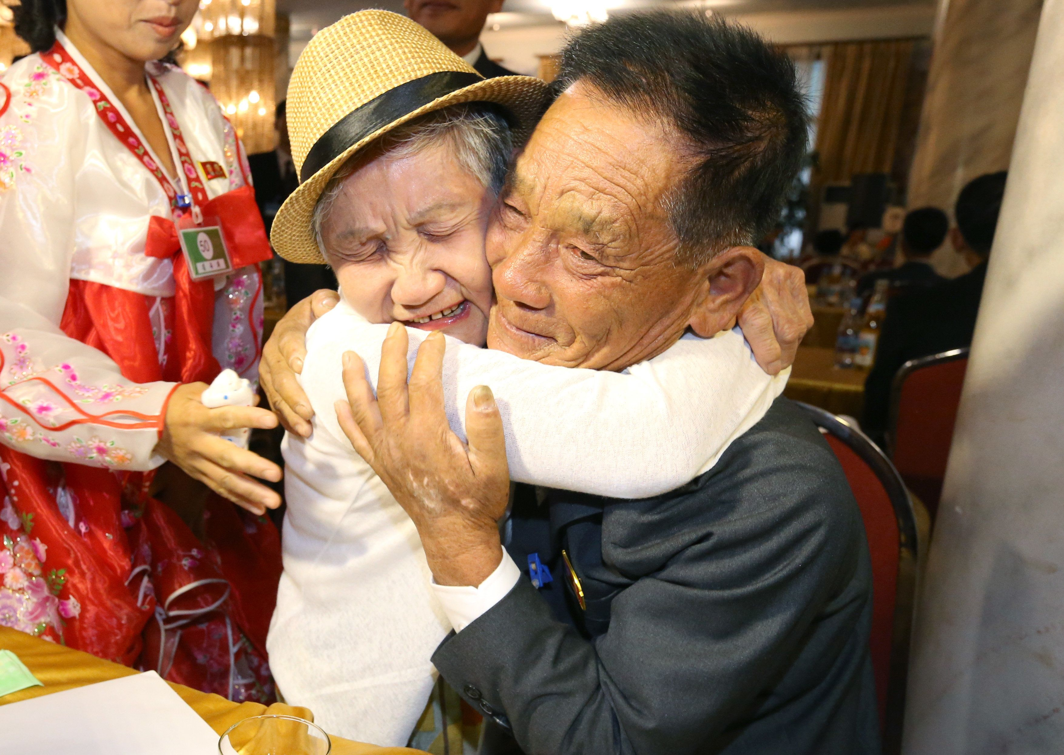 TOPSHOT - South Korean Lee Keum-seom (L), 92, meets with her North Korean son Ri Sung Chol (R), 71, during a separated family reunion meeting at the Mount Kumgang resort on the North's southeastern coast on August 20, 2018. - Dozens of elderly and frail South Koreans met their Northern relatives on August 20 for the first time since the peninsula and their families were divided by war nearly seven decades ago. (Photo by KOREA POOL / KOREA POOL / AFP) / South Korea OUT / REPUBLIC OF KOREA OUT        (Photo credit should read KOREA POOL/AFP/Getty Images)