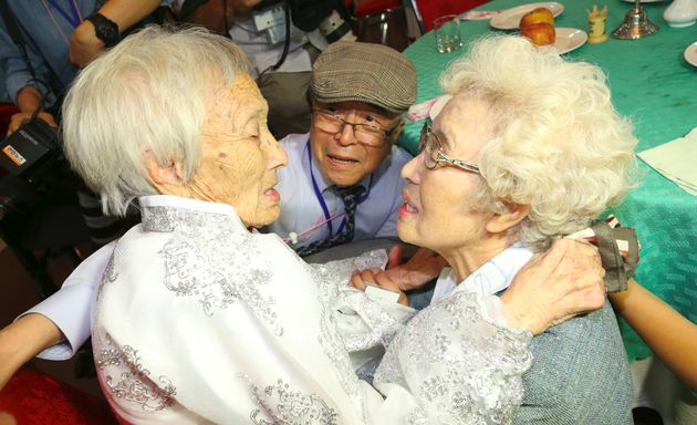 South Koreans Jo Hye-do (R), 86, and Jo Do-jae (C), 75, meet their North Korean sister Jo Soon Do (L),...