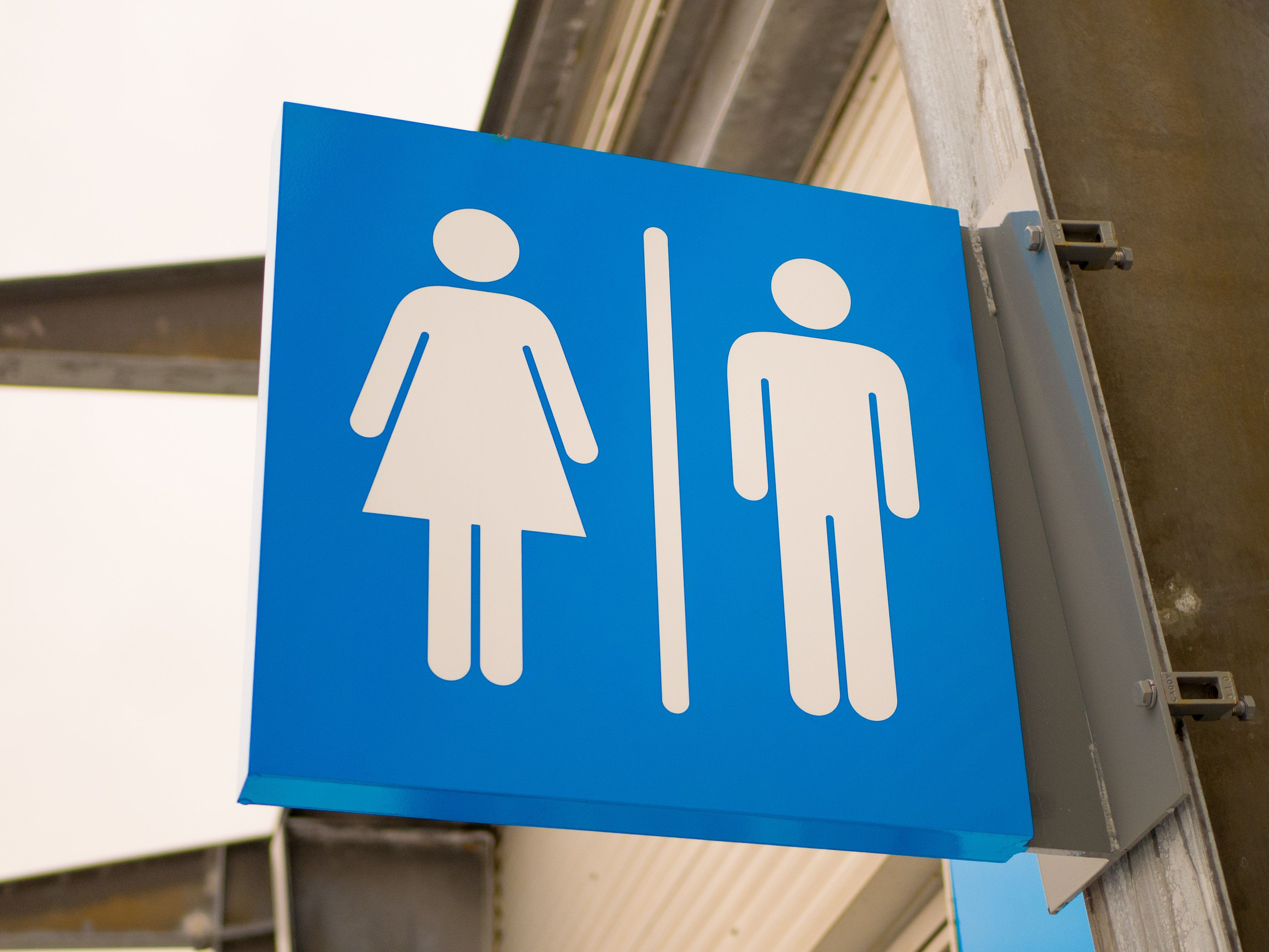 Outdoor blue toilets sign