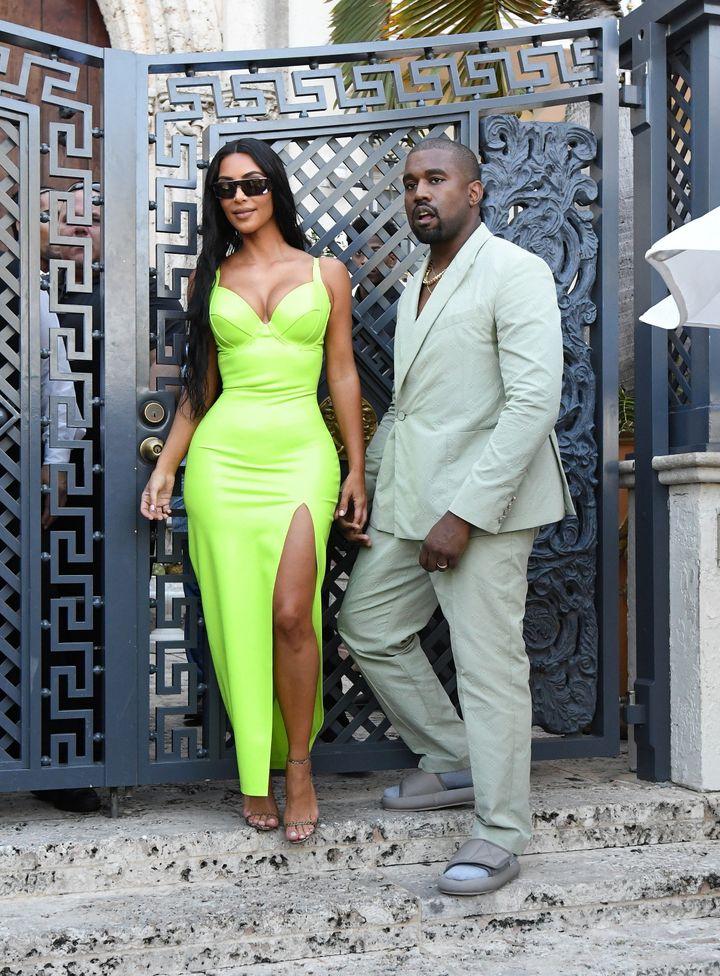 Kim Kardashian and Kanye West in Miami at a wedding on Saturday.