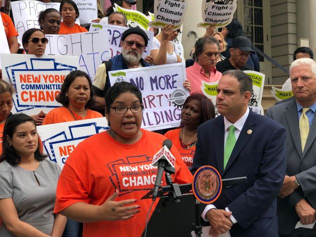 Rachel Rivera speaks at Monday's press conference, while Councilman Costa Constantinides stands to her