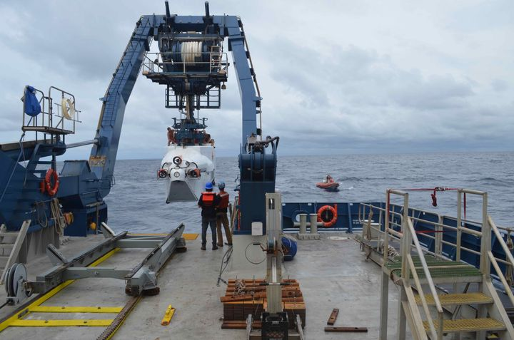 The deep-sea submersible Alvin is launched from R/V Atlantis off the coast of Delaware on Monday. A research team has planned 12 dives over the next two weeks to explore and study deep ocean ecosystems off the southeast coast.