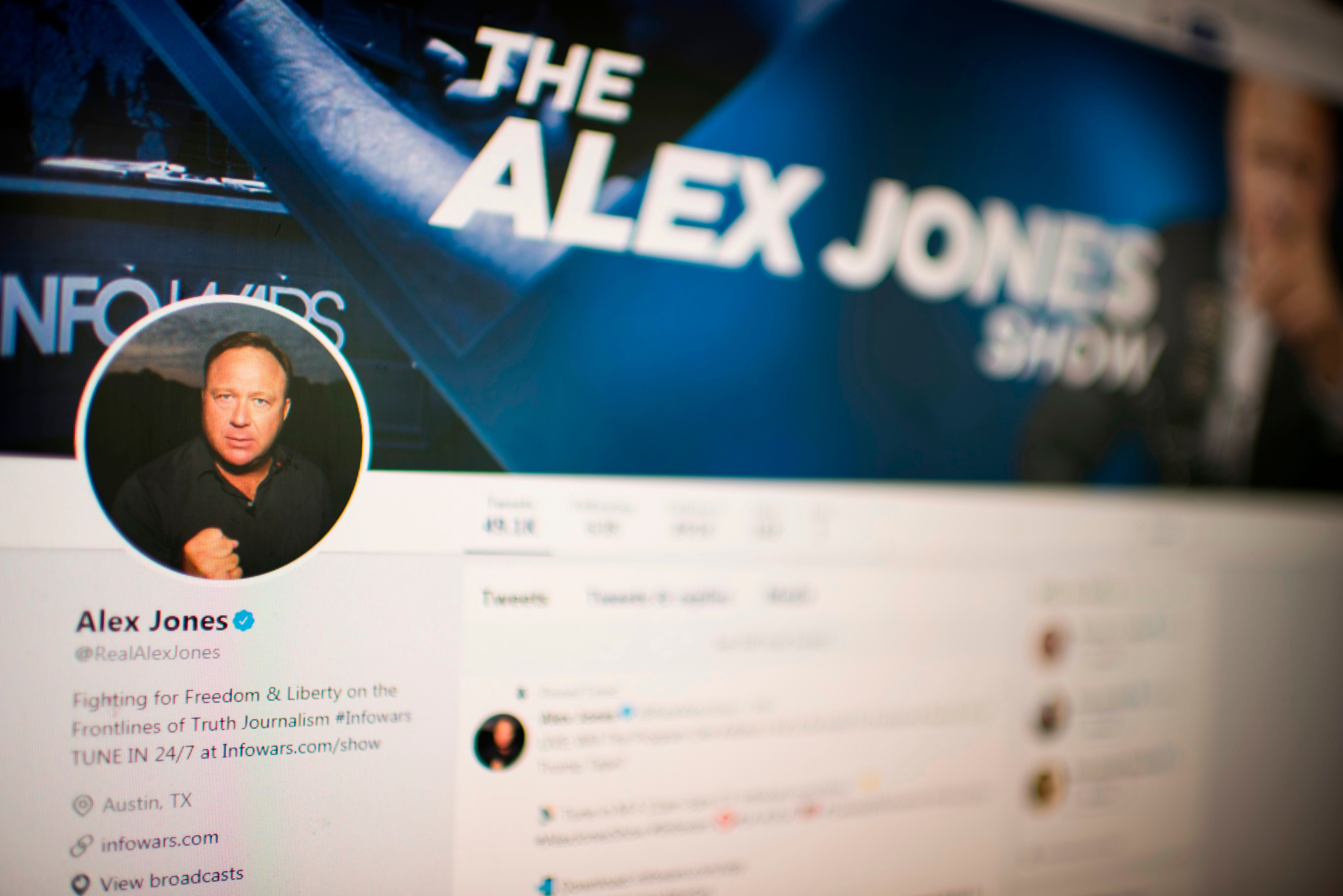 Picture showing a computer screen displaying the Twitter account of Far-right conspiracy theorist Alex Jones taken on August 15, 2018 in Washngton DC. - Far-right conspiracy theorist Alex Jones said his Twitter account had been suspended for a week, the latest online platform to take action against the activist. Twitter suspended the personal account of Jones, who operates the Infowars website that has disputed the veracity of the September 11 attacks, the Sandy Hook school massacre and other events. (Photo by Eric BARADAT / AFP)        (Photo credit should read ERIC BARADAT/AFP/Getty Images)