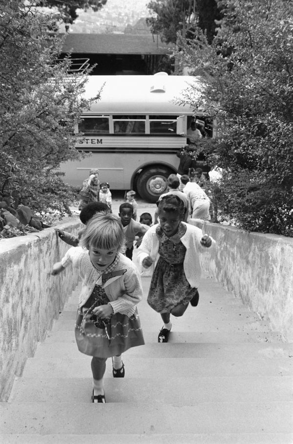 Children walk up a flight of stairs to attend a newly desegregated school in Berkeley, California, in 1968.