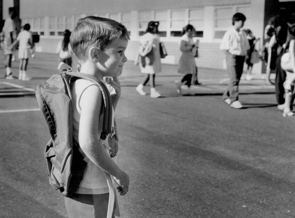 Five-year-old Dylan O' Sullivan appears determined to make it a good year as he heads into class in Denver on Aug. 30, 1989.