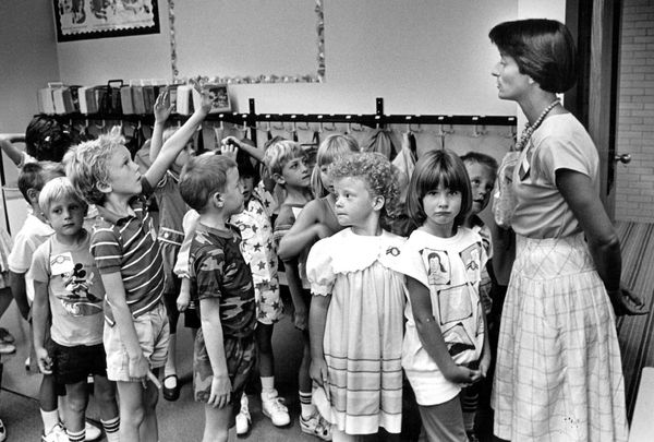 Students line up at the Side Creek Elementary School in Aurora, Colorado, on Aug. 11, 1987.