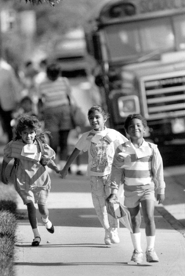 Schools kids arrive at Ellis Elementary School inDenver on Aug. 31, 1988.
