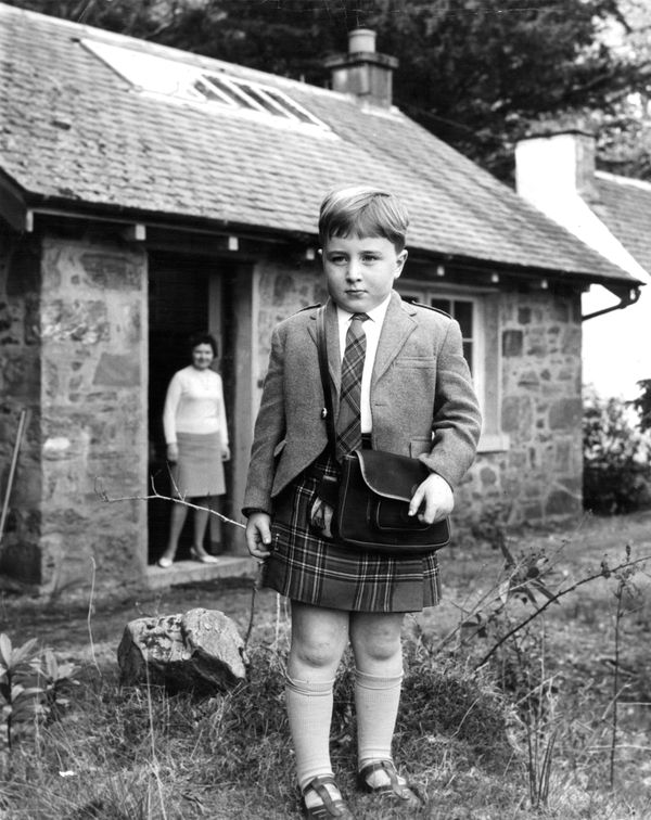 Teacher Agnes Bolton stands in the schoolhouse door on the first day of classes for her only pupil, Jimmy MacLellan, in Scotl