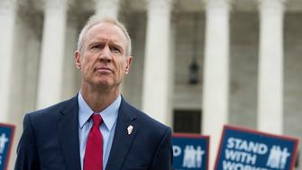 UNITED STATES - JUNE 27: Gov. Bruce Rauner, R-Ill., stands outside of the U.S. Supreme Court after the decision in the Janus v. AFSCME case was handed down in llinois state employee Mark Janus' favor on Wednesday, June 27, 2018. Janus argued the fees public-sector unions collect from nonmembers to cover the cost of actions that help all employees are coerced speech that violated his First Amendment rights. (Photo By Bill Clark/CQ Roll Call)
