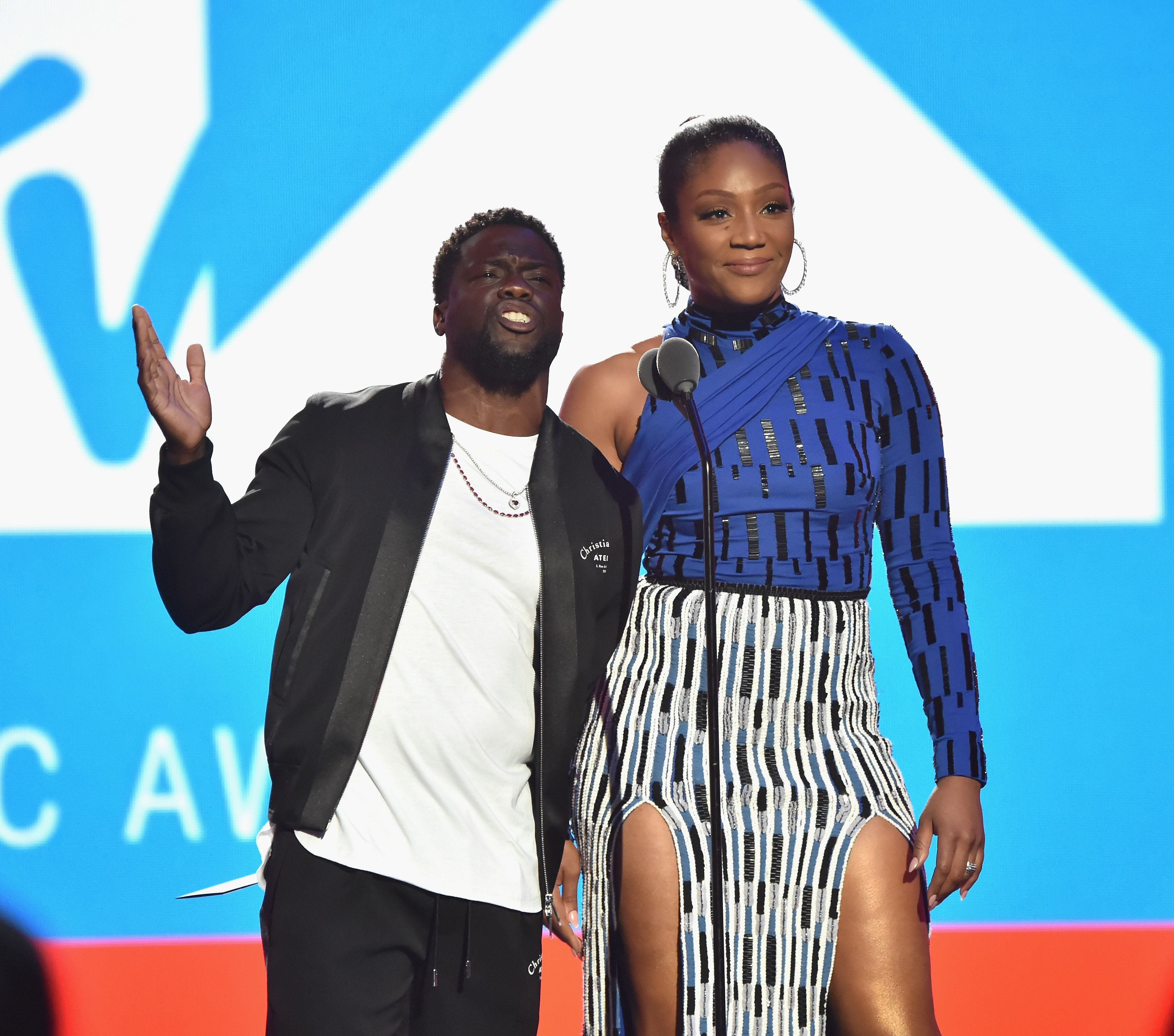 NEW YORK, NY - AUGUST 20:  Kevin Hart and Tiffany Haddish speak onstage during the 2018 MTV Video Music Awards at Radio City Music Hall on August 20, 2018 in New York City.  (Photo by Kevin Mazur/WireImage)