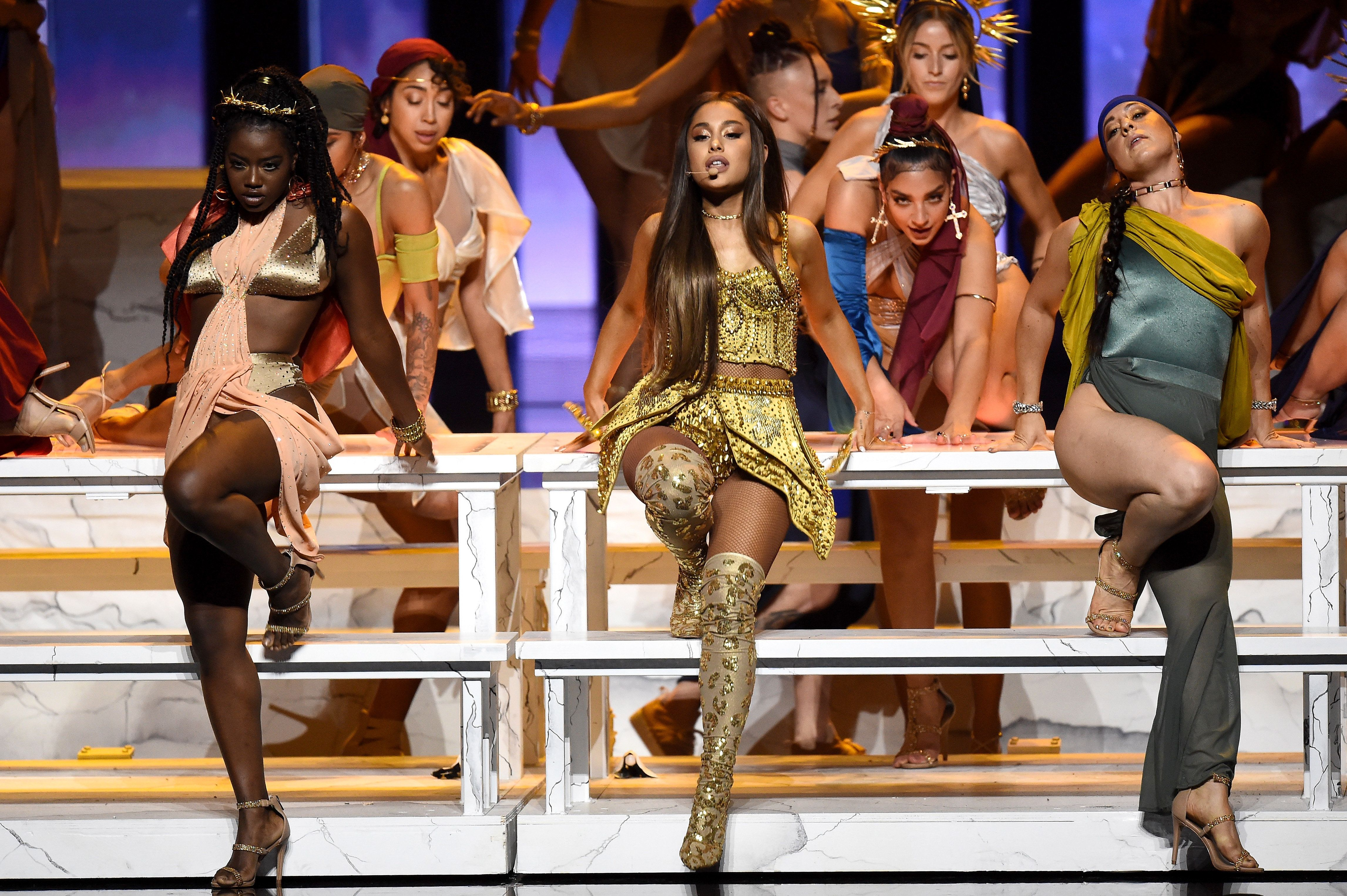 NEW YORK, NY - AUGUST 20:  Ariana Grande (center) performs onstage during the 2018 MTV Video Music Awards at Radio City Music Hall on August 20, 2018 in New York City.  (Photo by Michael Loccisano/Getty Images for MTV)