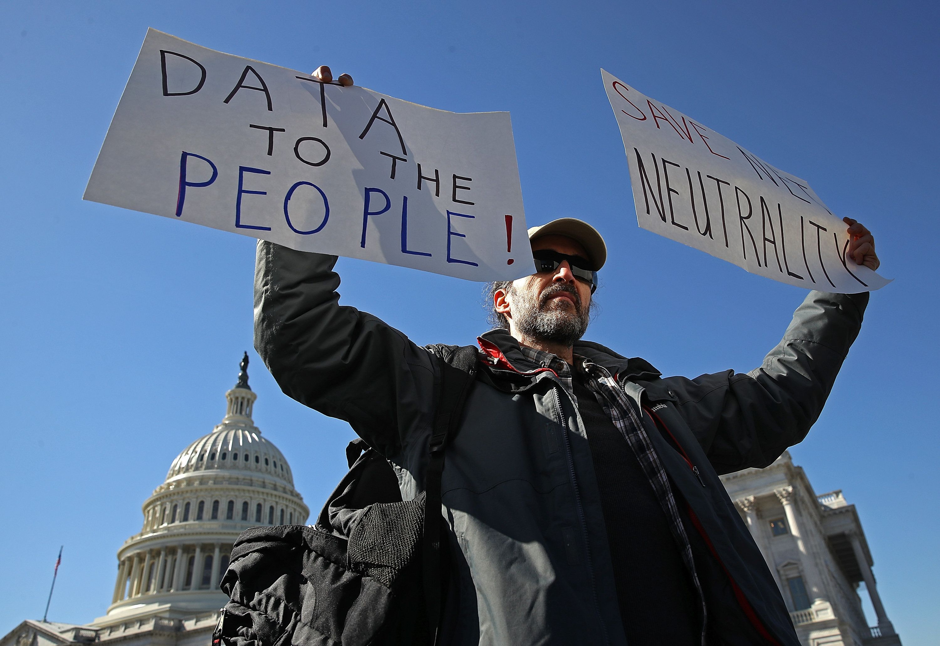 WASHINGTON, DC - FEBRUARY 27:  Mike Adkins joins roponents of an open and unregulated internet while attending a news conference at the U.S. Capitol February 27, 2018 in Washington, DC. Today has been designated a 'net neutrality day of action'by proponents of the legislation.  (Photo by Win McNamee/Getty Images)