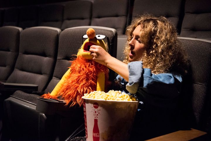 "The author shares popcorn with her Puppet Boyfriend at a screening of ""The Happytime Murders."""