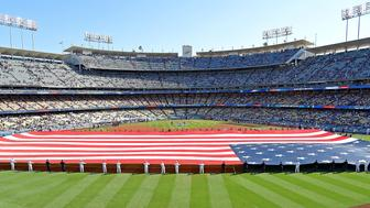 LOS ANGELES, CA - JULY 04:  Armed forces service members hold an American flag in the outfield during the National Anthem before the game between the Los Angeles Dodgers and the Pittsburgh Pirates at Dodger Stadium on July 4, 2018 in Los Angeles, California.  (Photo by Jayne Kamin-Oncea/Getty Images)