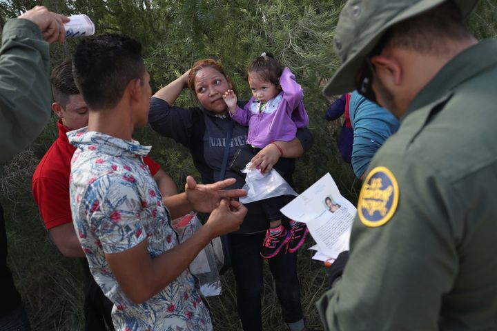 U.S. Border Patrol agents ask a group of Central American asylum-seekers to remove hair bands and wedding rings before taking