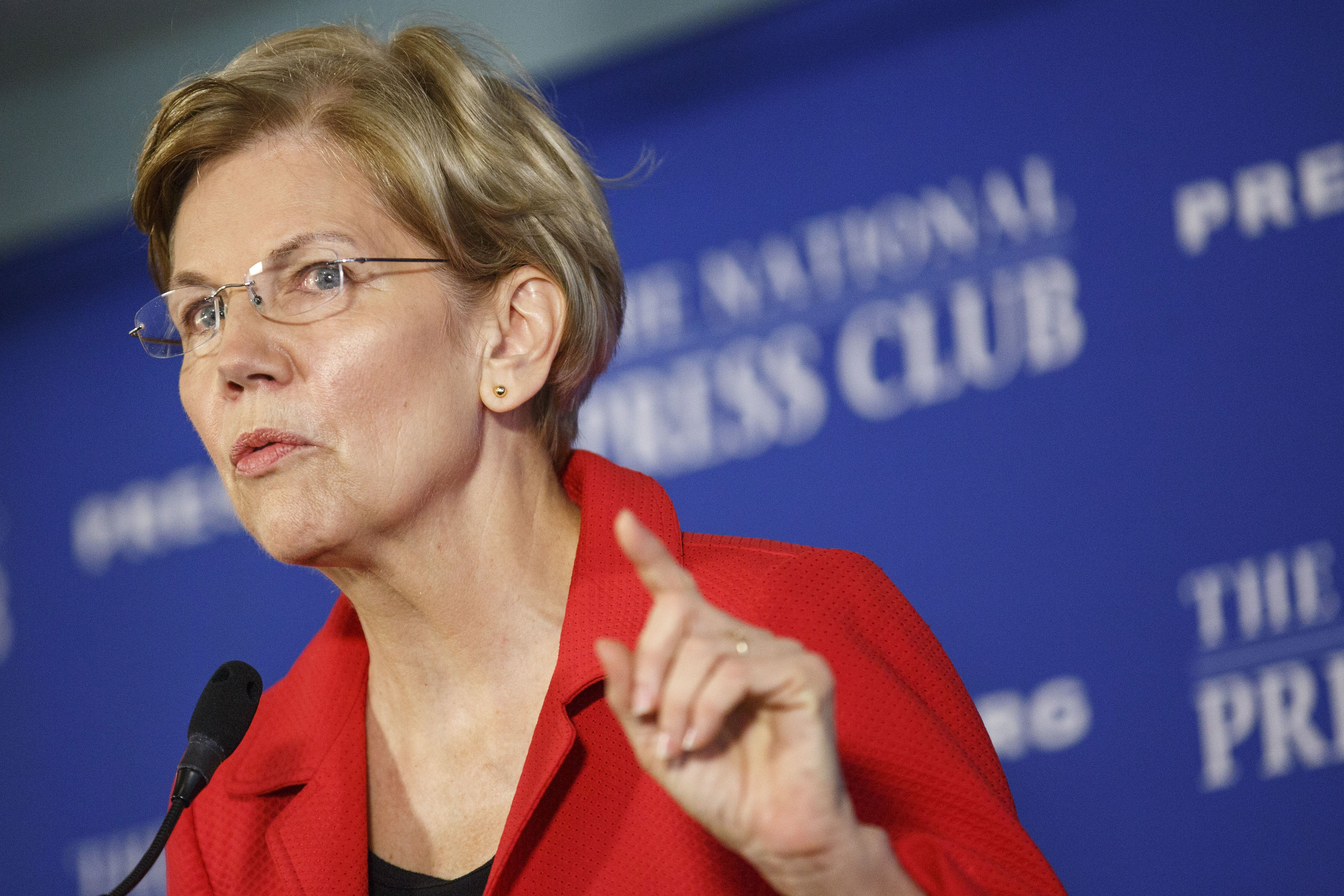 Senator Elizabeth Warren, a Democrat from Massachusetts, speaks during an event at the National Press Club in Washington, D.C., U.S., on Tuesday, Aug. 21, 2018. Declaring that big money has created a culture of corruption that colors virtually every important decision in Washington, Warren proposed a sweeping package of restrictions that would create a sea-change in the way the nation's capital operates. Photographer: Joshua Roberts/Bloomberg via Getty Images
