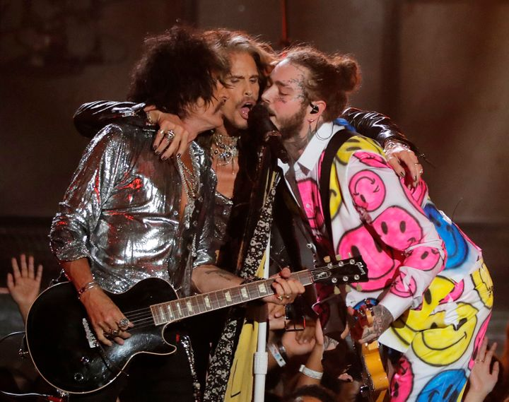 Post Malone performs with Joe Perry and Steven Tyler during the MTV Video Music Awards on Monday.