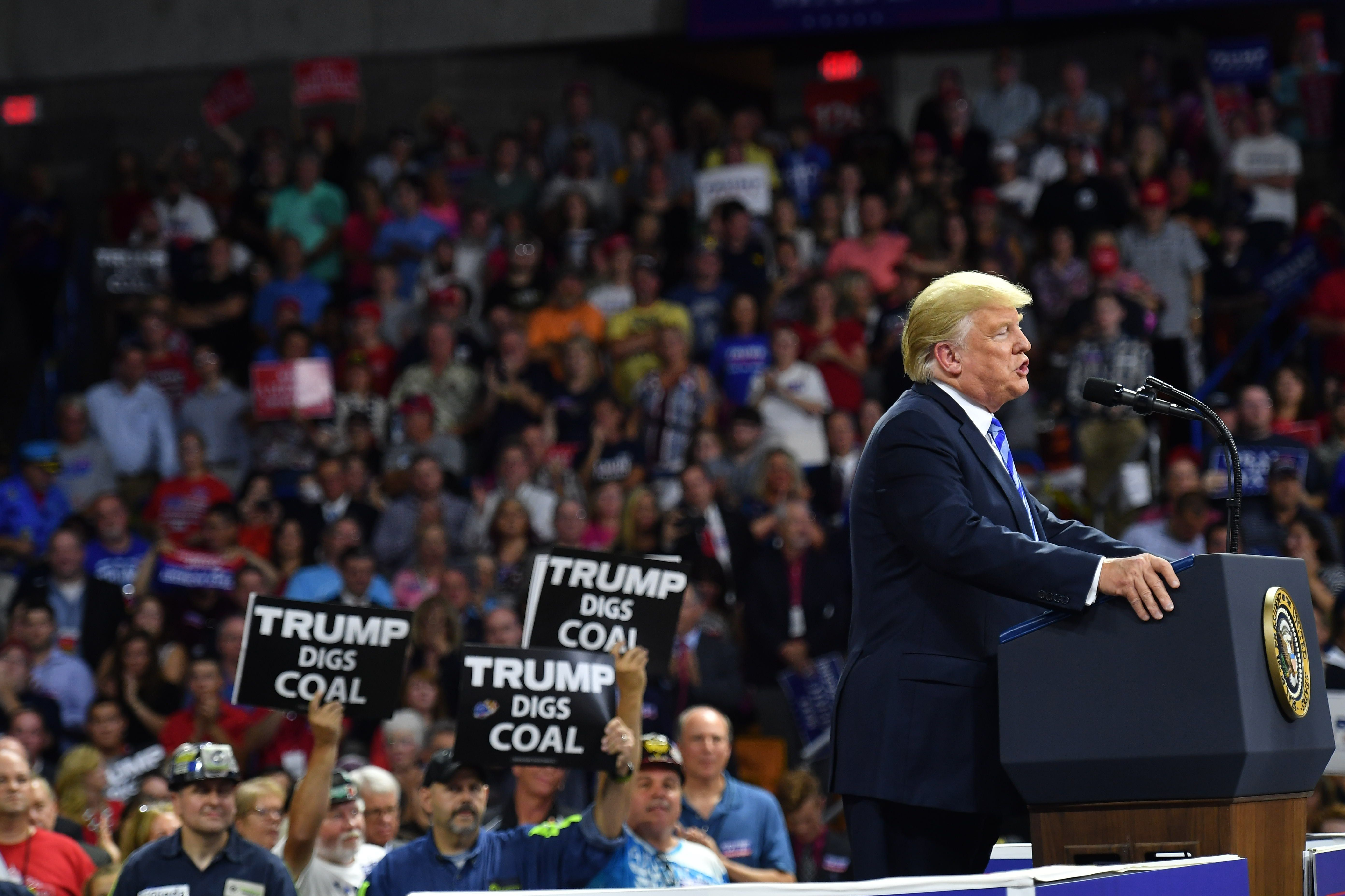 US President Donald Trump speaks during a political rally at Charleston Civic Center in Charleston, West Virginia on August 21, 2018. - Trump's administration announced a plan on August 21 to weaken regulations on US coal plants, giving a boost to an industry that former leader Barack Obama had hoped to wind down in order to cut harmful emissions that drive global warming. (Photo by MANDEL NGAN / AFP)        (Photo credit should read MANDEL NGAN/AFP/Getty Images)