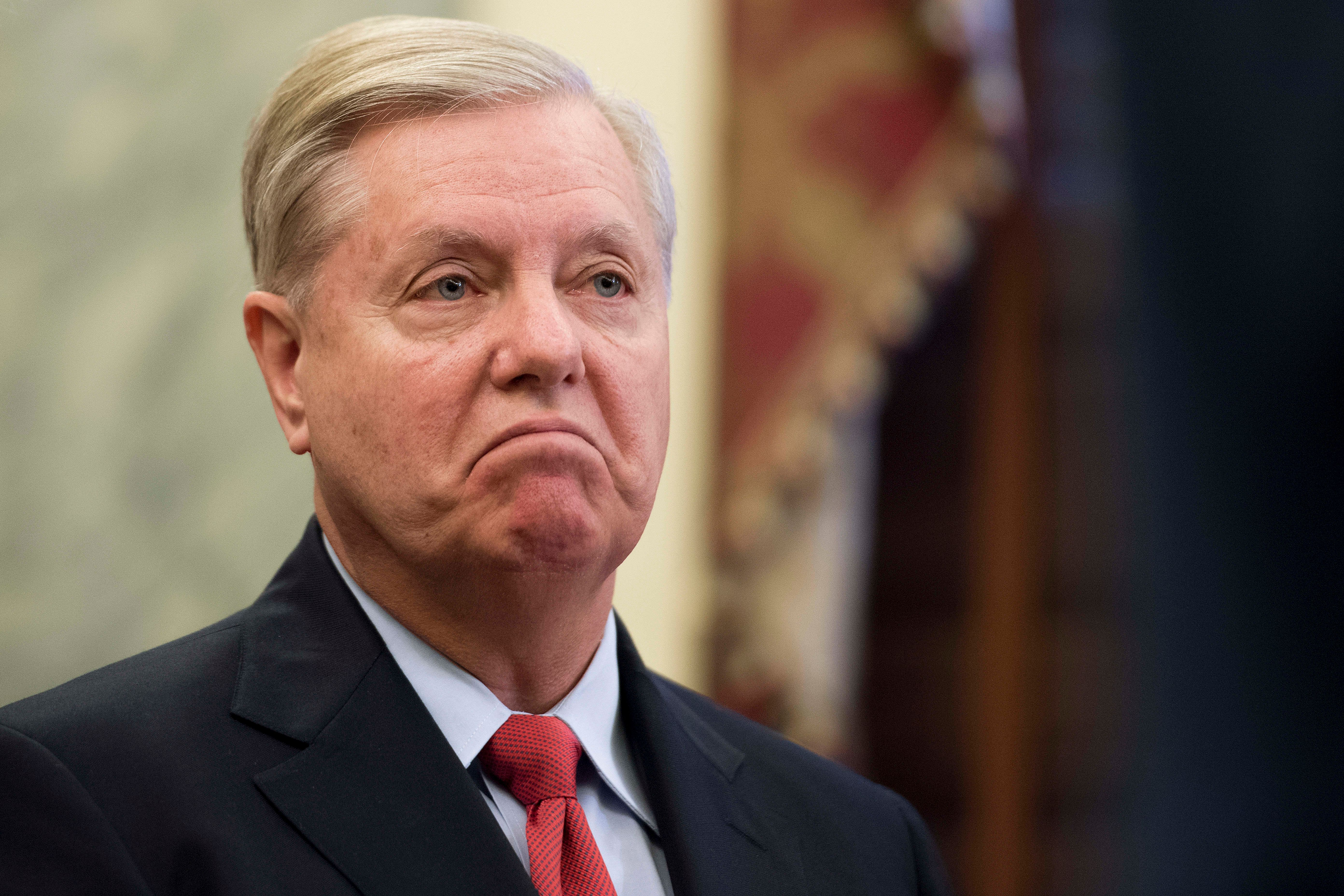 Senator Lindsey Graham, R-SC, announces legislation to repeal and replace Obamacare through block grants on Capitol Hill in Washington, DC, on September 13, 2017.   / AFP PHOTO / JIM WATSON        (Photo credit should read JIM WATSON/AFP/Getty Images)