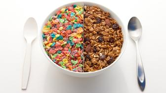 Bowl filled with half artificially colored, sugar coated cereal, and half organic granola