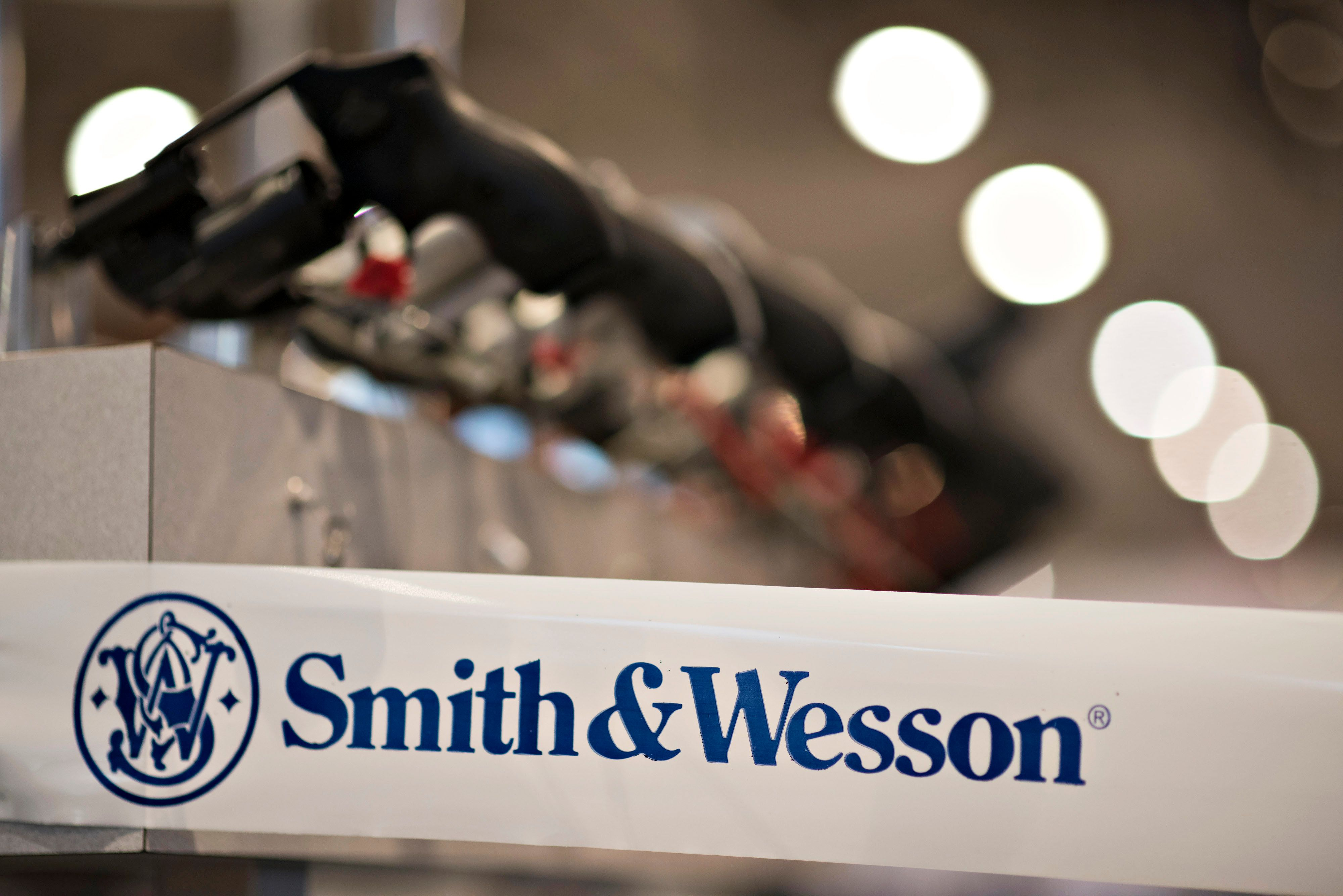 A Smith & Wesson Holding Corp. logo appears on tape surrounding the company's booth on the exhibition floor ahead of the 144th National Rifle Association (NRA) Annual Meetings and Exhibits at the Music City Center in Nashville, Tennessee, U.S., on Thursday, April 9, 2015. Top Republican contenders for their party's 2016 presidential nomination are lining up to speak at the annual NRA event, except New Jersey Governor Chris Christie and Kentucky Senator Rand Paul who were snubbed by the country's largest and most powerful gun lobby. Photographer: Daniel Acker/Bloomberg via Getty Images