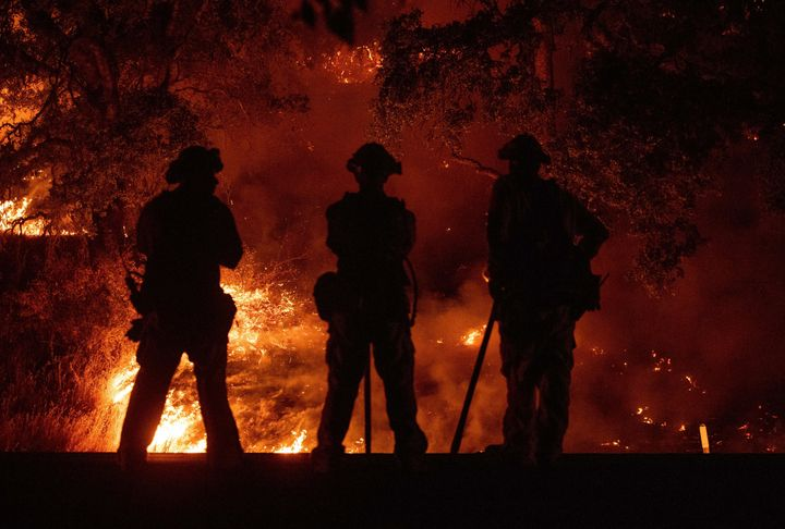 Firefighters watch a back burn during the Mendocino Complex fire in Upper Lake, California, on July 31.