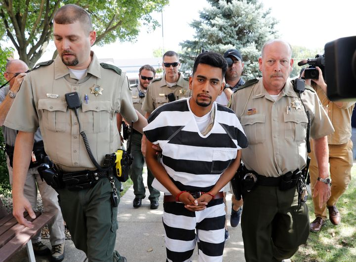 Cristhian Bahena Rivera is escorted into the Poweshiek County Courthouse for his initial court appearance on Wednesday i
