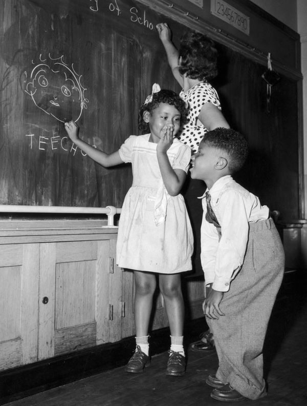 Joyce Payne and Vincent Baker have fun depicting their teacher at a school in New York's Harlem community on Sep. 13, 1948.