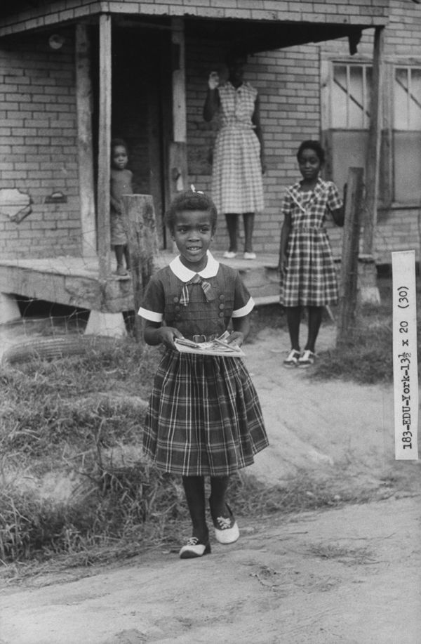 Delores York heads off for her first day at a previously all-white school in September 1960 in Arkansas.
