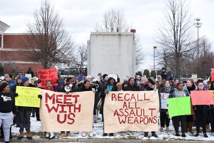 Students, educators and faith leaders hold a rally in front of Smith & Wesson world headquarters in Springfield, Massachu
