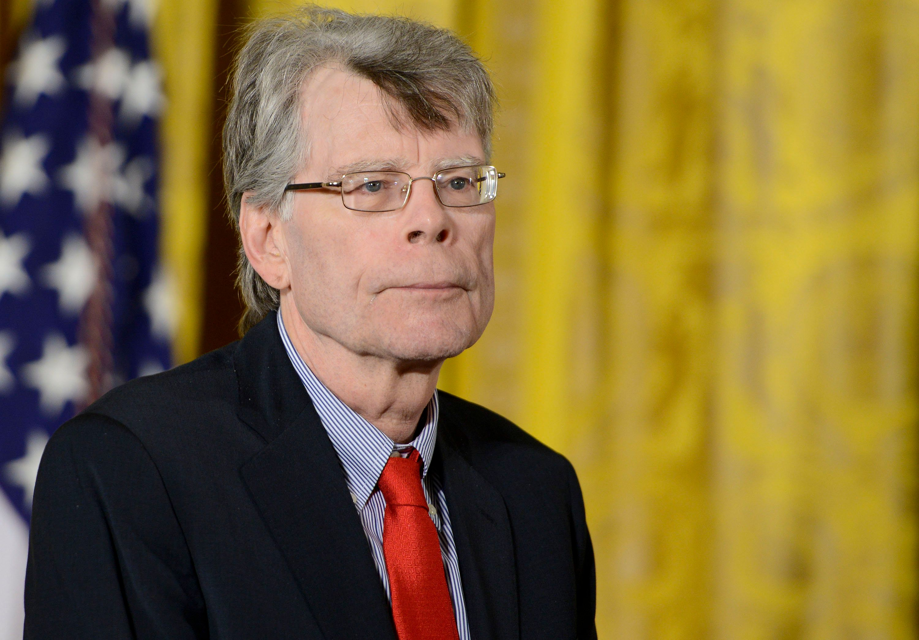 WASHINGTON, DC - SEPTEMBER 10:  President Barack Obama presents author Stephen King with the 2014 National Medal of Arts at The White House on September 10, 2015 in Washington, DC.  (Photo by Leigh Vogel/WireImage)