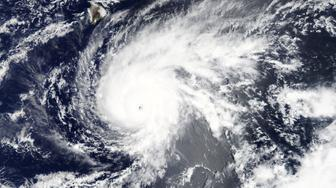 Hurricane Lane, upgraded to a Category 5 storm, is pictured approaching Hawaii, U.S. in this August 21, 2018 handout satellite photo obtained by Reuters August 22, 2018.   NASA/Handout via REUTERS ATTENTION EDITORS - THIS IMAGE WAS PROVIDED BY A THIRD PARTY.