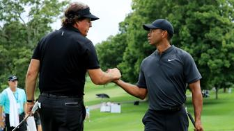 AKRON, OH - AUGUST 01:  Phil Mickelson (L) and Tiger Woods meet during a preview day of the World Golf Championships - Bridgestone Invitational at Firestone Country Club South Course at on August 1, 2018 in Akron, Ohio.  (Photo by Sam Greenwood/Getty Images)