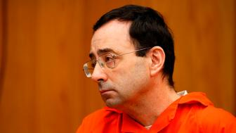 Former Michigan State University and USA Gymnastics doctor Larry Nassar listens during the sentencing phase in Eaton, County Circuit Court on January 31, 2018 in Charlotte, Michigan.  The number of identified sexual abuse victims of former USA Gymnastics doctor Larry Nassar has grown to 265, a Michigan judge announced Wednesday as a final sentencing hearing commenced. Prosecutors said at least 65 victims were to confront Nassar in court, in the last of three sentencing hearings for the disgraced doctor who molested young girls and women for two decades in the guise of medical treatment.  / AFP PHOTO / JEFF KOWALSKY        (Photo credit should read JEFF KOWALSKY/AFP/Getty Images)