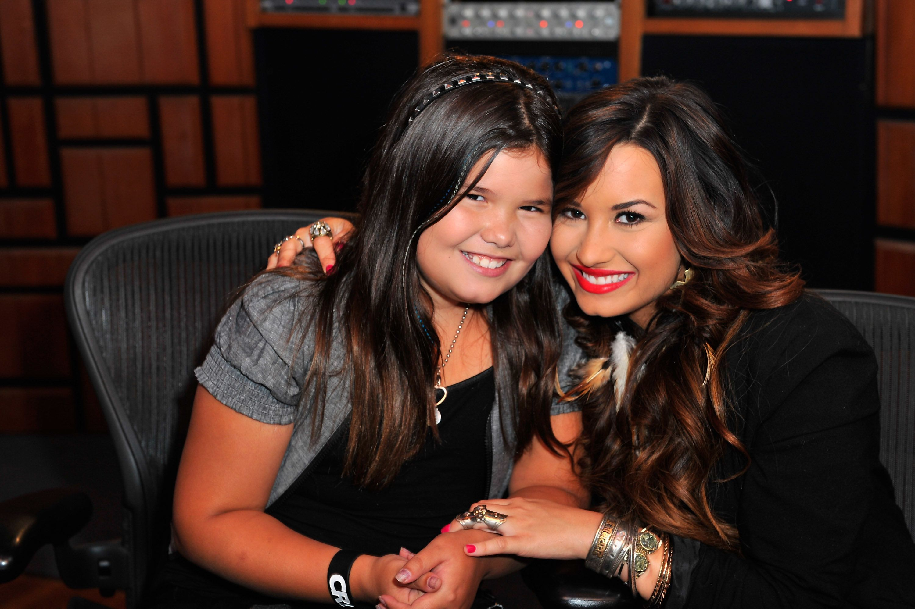 HOLLYWOOD, CA - JULY 21:  Actress/singer Demi Lovato (R) and sister actress Madison De La Garza attend a Live Chat at Cambio Studios on July 21, 2011 in Hollywood, California.  (Photo by Alberto E. Rodriguez/Getty Images)