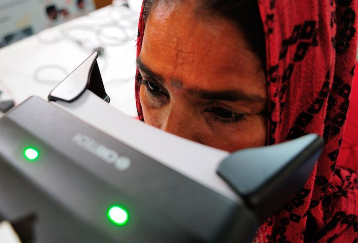 A woman is screened for an Aadhaar card on April 12, 2013, in New Delhi, India.